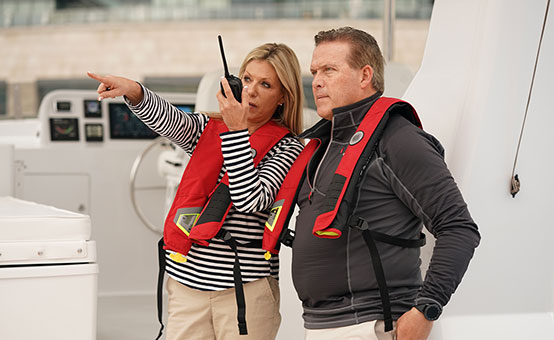 boaters wearing lifejackets using VHF radio