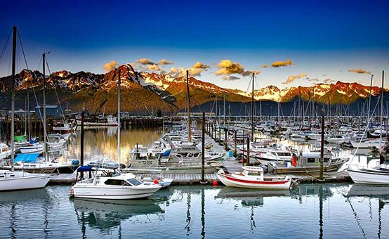 boaters enjoy a spectacular view from an Alaskan marina