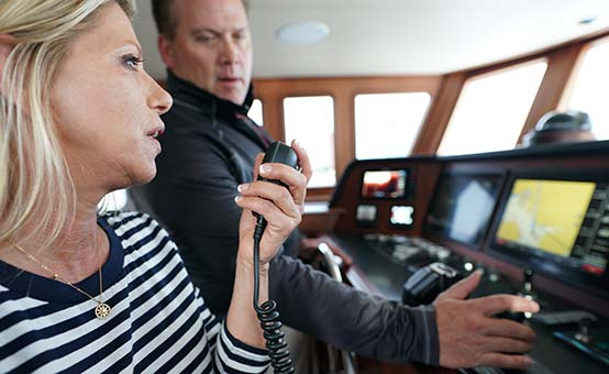 trawler boaters use vhf radio to call mayday