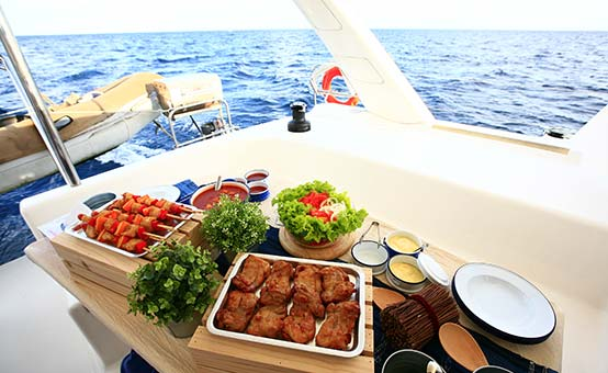 eating well lunch at sea on a catamaran sailboat