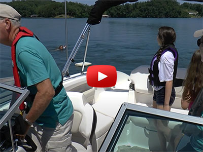 Family practices man overboard drills by maneuvering the boat to safely recover a person in the water