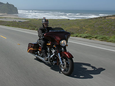 motorcycle riders cruising a coastal highway