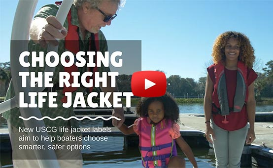 boating instructor helps family wearing life jackets onto a boat
