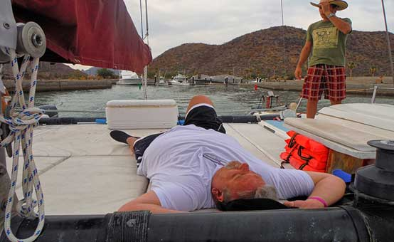 sick boater lying on the bow