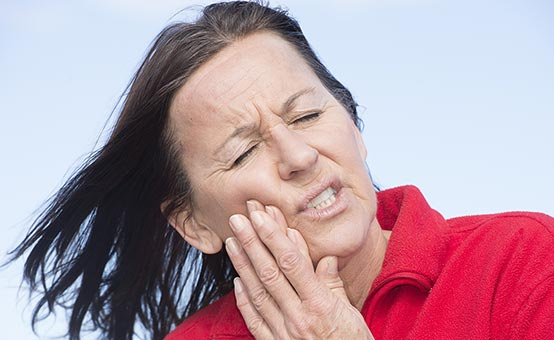 female boater suffers from toothache jaw pain